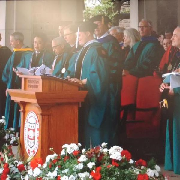 Dereck Basinger sings at All-University Commencement